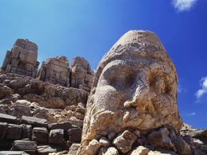 Ancient Stone Sculpture, Nemrut Dag, Turkey by Adam Woolfitt