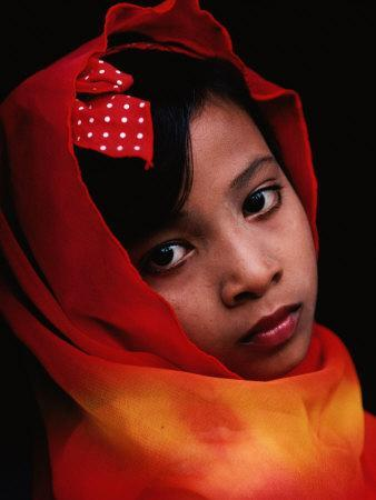A Portrait of a Muslim Girl with Her Face Framed by a Colourful Scarf, Indonesia
