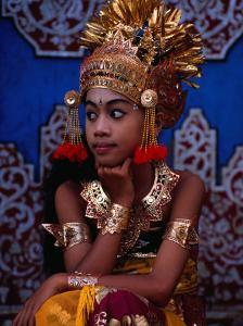 A Situ Dancer Relaxes on Temple Steps in Singapadu, Sampalan, Indonesia by Adams Gregory