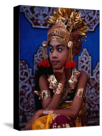 A Situ Dancer Relaxes on Temple Steps in Singapadu, Sampalan, Indonesia