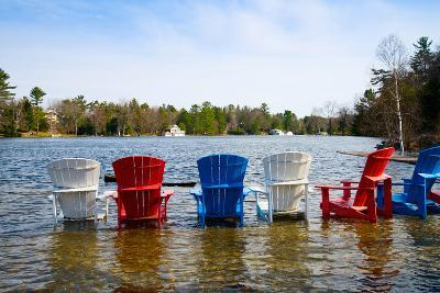Adirondack Chairs Partially Submerged in the Lake Muskoka, Ontario, Canada--Photographic Print