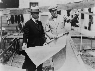 Adolph Zukor and Jesse Lasky at a Construction Site Holding Blueprints--Photo