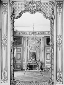 Photograph of a Mirror at the Chateau de Versailles with the Reflection of Giraudon's Camera by Adolphe Giraudon