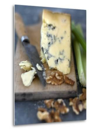 Blue Cheese and Walnuts with a Knife on a Chopping Board
