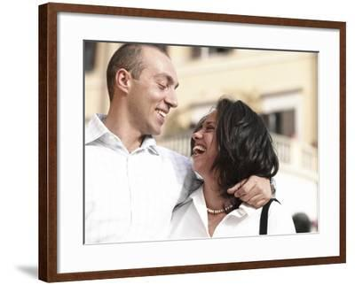 Adult Couple Laughing and Hugging--Framed Photographic Print