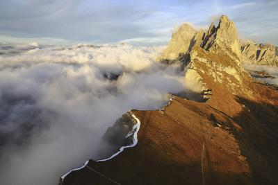 https://imgc.artprintimages.com/img/print/aerial-shot-from-seceda-of-odle-surrounded-by-clouds-at-sunset_u-l-q12sw3t0.jpg?p=0
