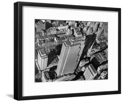 Aerial View Looking Down on 6th Ave. and 50th St. at Towering Rockefeller Center Complex-Margaret Bourke-White-Framed Premium Photographic Print