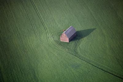 Aerial View of a Barn in the Middle of a Lush Green Field-Paul Chesley-Photographic Print