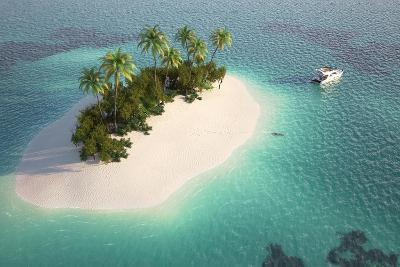 Aerial View of a Caribbean Desert Island in a Turquoise Water with a Woman Diving and a Yacht as a-Pablo Scapinachis-Art Print