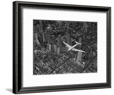 Aerial View of a Dc-4 Passenger Plane in Flight over Manhattan-Margaret Bourke-White-Framed Premium Photographic Print