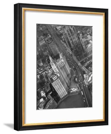 Aerial View of Buildings and a Bridge Crossing a River Flowing Through the City-Margaret Bourke-White-Framed Premium Photographic Print