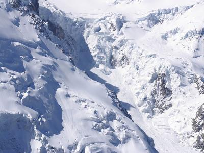 Aerial View of Cold Snow with Jagged Formations on a Rocky Mountain--Photographic Print