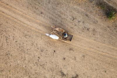 Aerial View of Farmer on Dirt Road in Bagan, Myanmar-Harry Marx-Photographic Print