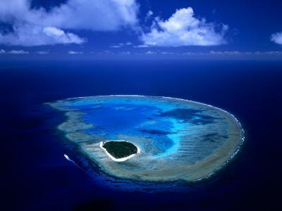 Aerial View of Island and Surrounding Reefs, Australia-Manfred Gottschalk-Photographic Print