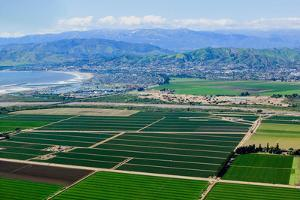 Aerial view of Oxnard farm fields in spring with Ventura City and Pacific Ocean in background, V...
