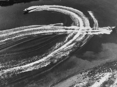 Aerial View of Waterskiers and Motorboats Speeding across the Pacific Ocean at Marine Stadium-Margaret Bourke-White-Photographic Print