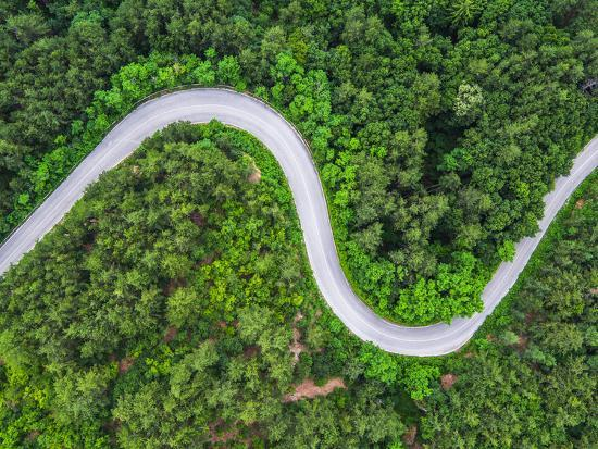 Aerial View over Mountain Road Going through Forest Landscape-Valentin Valkov-Photographic Print