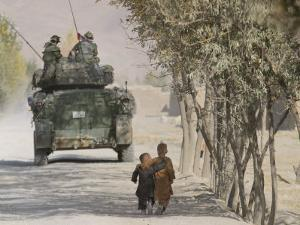 Afghan Boys Walk Along a Path While International Security Assistance Force (Isaf)