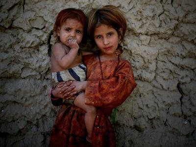 Afghan Girl Holds Her Younger Sister in Nangarhar Province, East of Kabul, Afghanistan--Photographic Print