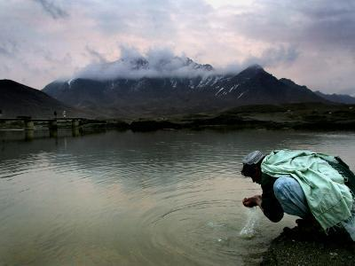 Afghan Man Washes His Face in the River before Going to Evening Prayers--Photographic Print
