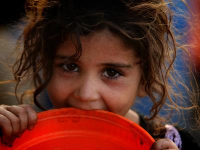 Afghan Refugee Child Who Lives in Slum Area of Lahore City in Pakistan Waits to Get Water--Photographic Print