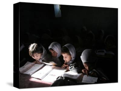 Afghan School Girls Read their Lessons at the Aziz Afghan Secondary School in Kabul, Afghanistan