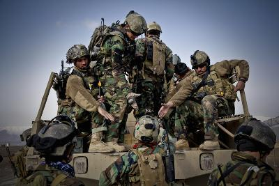 Afghan Soldiers Give a Hand Up to a Fellow Soldier--Photographic Print