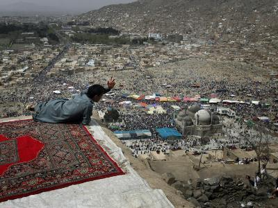 Afghan Youth Sits on a Rooftop During the Celebration of Nowruz--Photographic Print