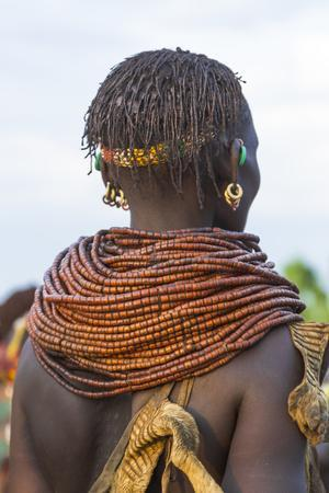 https://imgc.artprintimages.com/img/print/africa-ethiopia-southern-omo-valley-nyangatom-woman-wear-heavy-beads-and-other-decorations_u-l-q1blk1z0.jpg?p=0