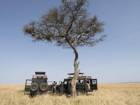 Africa, Kenya, Maasai Mara National Reserve. Tourists having lunch on Maasai Mara.-Jaynes Gallery-Photographic Print