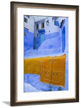 Africa, Morocco, Chefchaouen. Rugs Draped on a Wall in the Blue Town-Brenda Tharp-Framed Photographic Print