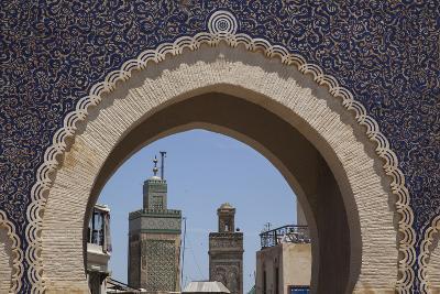 Africa, Morocco, Fes. an Arch with Classic Moorish Decor Frames Two Minarets-Brenda Tharp-Photographic Print