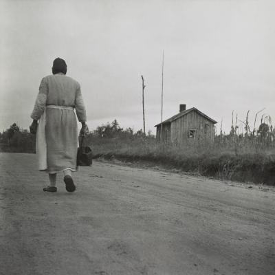 African American Midwife Carrying Her Medical Bag on a Dirt Road in Georgia--Photo