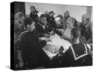 African American Soldiers and Sailors Playing Cards at the USO Recreation Center