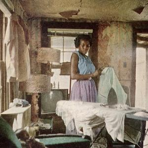 African American Virginia Lee Tanner Ironing in Her Rented House