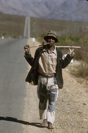 https://imgc.artprintimages.com/img/print/african-man-walks-along-side-of-road-durban-south-africa-1960_u-l-q130y4o0.jpg?p=0