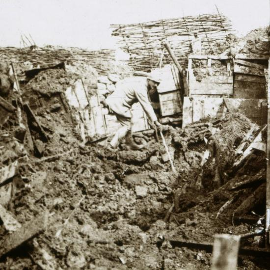 Aftermath of a shell, a soldier in the crater, c1914-c1918-Unknown-Photographic Print
