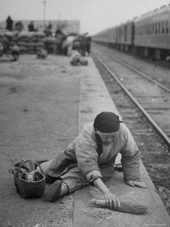 https://imgc.artprintimages.com/img/print/aged-refugee-fighting-hunger-sweeps-up-spilled-rice-on-the-railroad-station-platform_u-l-p3myfl0.jpg?p=0