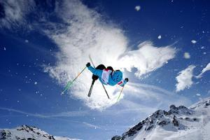 Competitive Mogul Skier Jumps off a Kicker by Agence Zoom