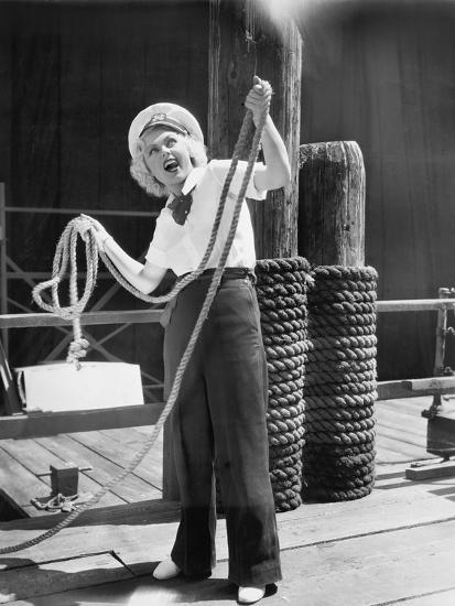 Ahoy, from a Young Woman in a Sailor's Outfit, Holding a Heavy Rope--Photo