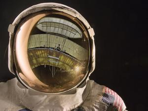 Air and Space: Apollo Helmet Visor reflecting the 1903 Wright Flyer