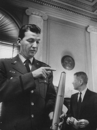 Air Force Major General Bernard A. Schriever Looking at a Model of a Rocket--Photographic Print