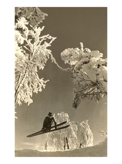 Airborne Skier Amid Frost-Laden Trees--Art Print