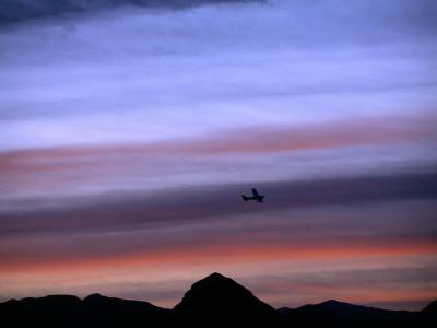 Aircraft and Mountains Silhouetted Against a Dramatic Sky at Dusk, Wyoming-Joel Sartore-Photographic Print