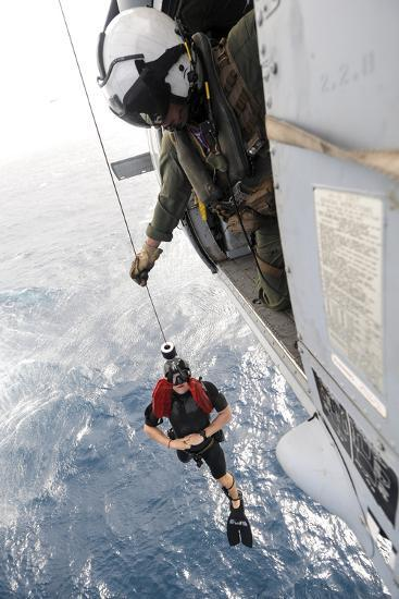 Aircrewman Assists in Hoisting a Member into an Mh-60S Sea Hawk--Photographic Print