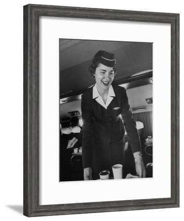 Airline Stewardess Seving Coffee-Peter Stackpole-Framed Photographic Print