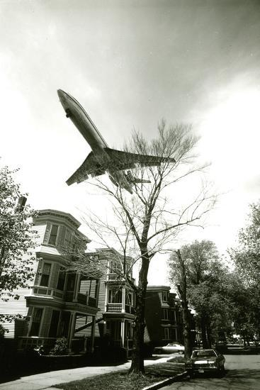 Airliner Above Residential Area--Photographic Print