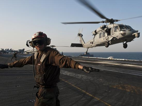 Airman Checks For a Clear Deck As An MH-60S Sea Hawk Takes Off USS John C. Stennis-Stocktrek Images-Photographic Print