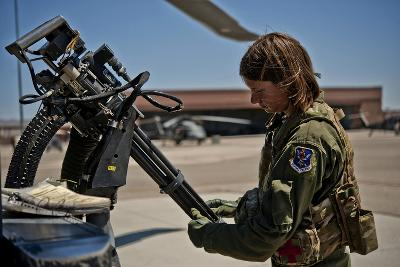 Airman Examines the Barrels of a Gau-2 Mini Gun on an Hh-60 Pave Hawk--Photographic Print