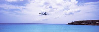 Airplane Flying over Sea, Princess Juliana International Airport, Maho Beach, Netherlands Antilles--Photographic Print